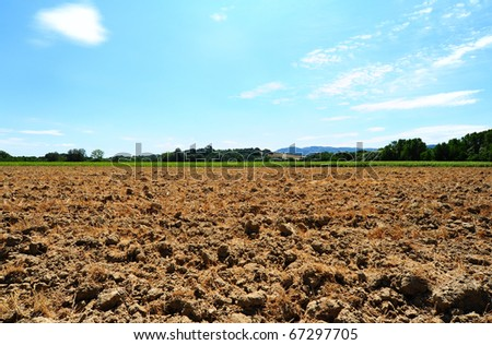 Freshly Plowed Field In Spring Ready For Cultivation - stock photo