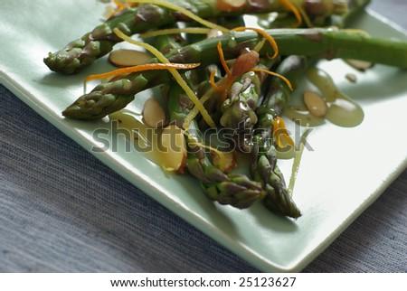 Freshly prepared asparagus almondine with citrus glaze. - stock photo