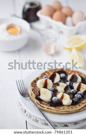 Freshly prepared crepes with banana & chocolate sauce - shallow dof - stock photo