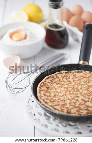 Freshly prepared crepes with maple syrup - shallow dof - stock photo