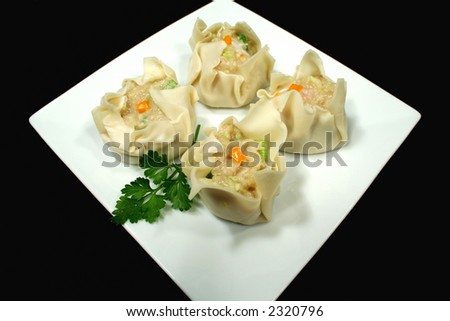Freshly prepared dim sums ready for the steamer. - stock photo