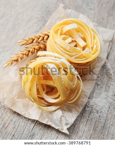 Freshly prepared fettuccine pasta closeup. Pasta tagliatelle with wheat. - stock photo