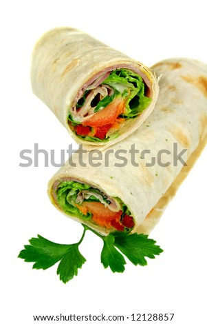 Freshly prepared ham and salad wrap ready to eat.