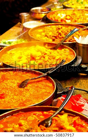 Freshly prepared oriental dishes on a market stall - stock photo