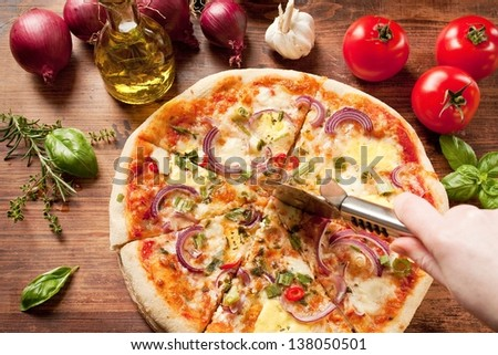 freshly prepared pizza, baked with herbs and vegetables - stock photo