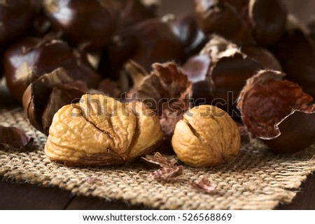 Freshly roasted or baked peeled chestnuts, photographed with natural light (Selective Focus, Focus on the front of the peeled chestnuts)