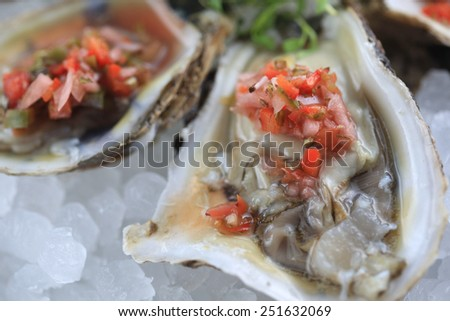 Freshly shocked local oysters with a mignonette sauce - stock photo