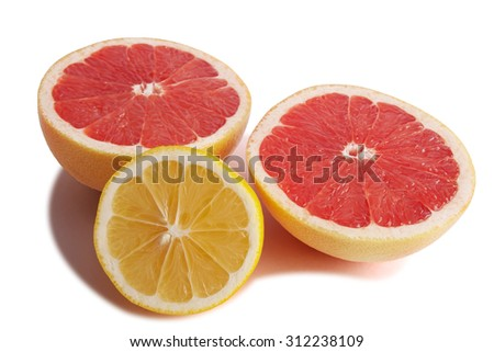 Freshly sliced halves of lemon and grapefruit isolated on white background.