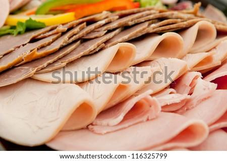 Freshly sliced mixed meat - stock photo