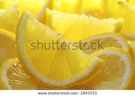Freshly sliced sun drenched lemons, also available in oranges and limes. - stock photo