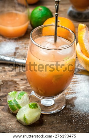 freshly squeezed citrus juice from oranges and tangerines.Selective focus.tinted - stock photo
