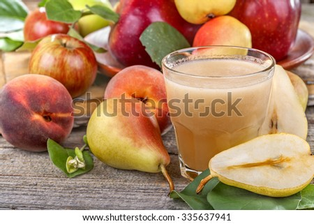 freshly squeezed juice made from organic and healthy pears, apples and peaches - stock photo