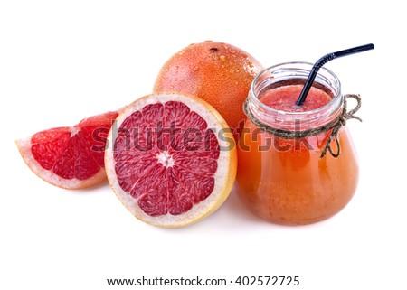freshly squeezed juice of red grapefruit on white background - stock photo