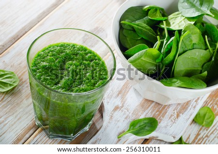 Freshly Squeezed Vegetable Juice  on wooden table. - stock photo