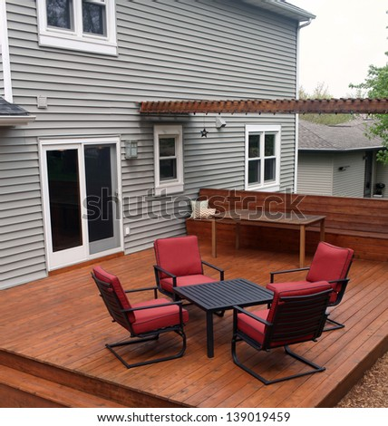 Freshly stained backyard deck - stock photo