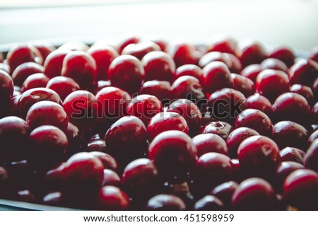 Freshly washed, delicious looking cherries - stock photo