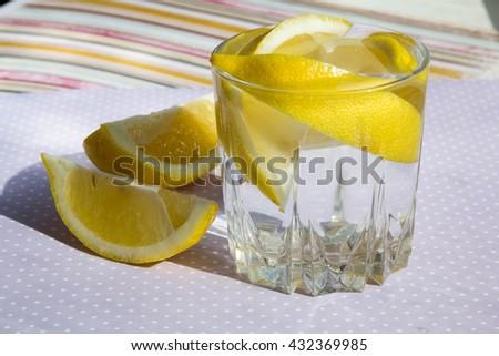 freshness concept, homemade lemonade Summer detox drink lemon in glass jars. Fresh water, refreshment drink - stock photo