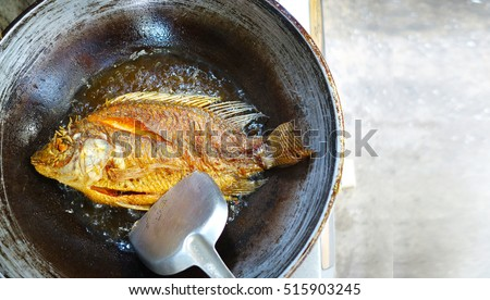 freshwater fish fried in a pan