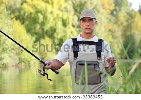Freshwater fisherman - stock photo