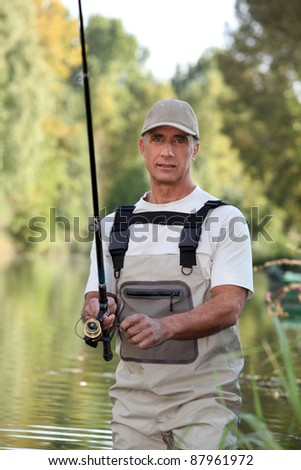 Freshwater fisherman in a river - stock photo