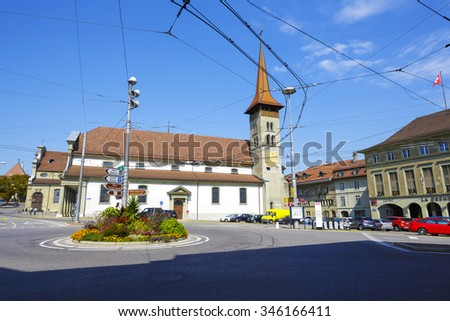 FRIBOURG, SWITZERLAND - SEPTEMBER 10, 2015: Basilica of Our Lady (Basilique de Notre-Dame), the oldest church in the city, dates back to the early thirteenth century - stock photo
