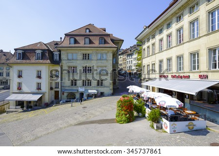 FRIBOURG, SWITZERLAND - SEPTEMBER 10, 2015: Urban scene of architecture in the capital city of the canton of Fribourg, which shares two linguistic regions between German and French cultures - stock photo