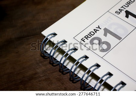 Friday, at the end of the month on organizer. - stock photo
