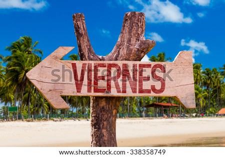 Friday (in Spanish) arrow with beach background - stock photo