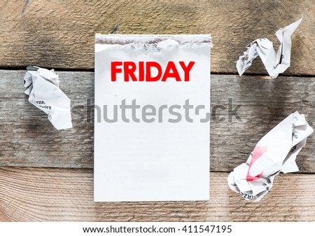 Friday. Paper sheet on a wooden wall with empty space - stock photo