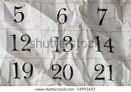 Friday the 13th crumpled calendar with scratches macro shot background