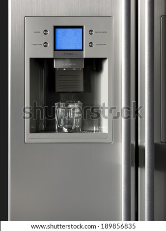 Fridge detail with ice dispenser and glass. Vertical - stock photo