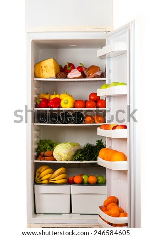 fridge full of food - stock photo