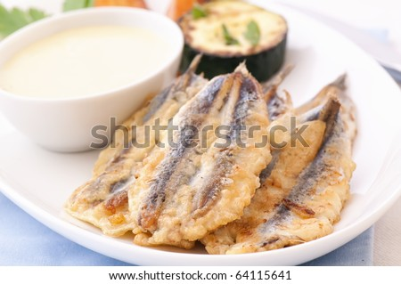 Fried Aanchovy with Aioli - stock photo