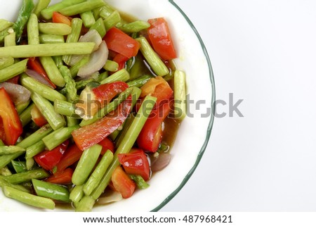 Fried asparagus with capsicum isolated on white.