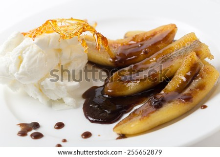 Fried bananas with a toffee sauce, ice cream and a caramelised sugar decoration.