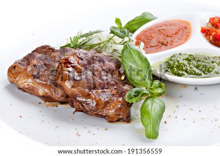 Fried beef liver with herbs, spices and sauce on a plate - stock photo