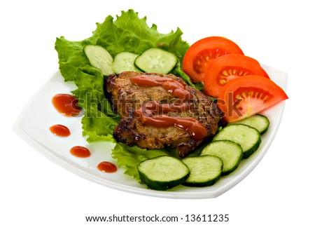Fried beef meat with vegetable garnish - stock photo
