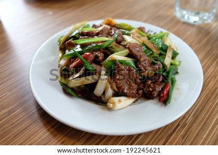 fried beef with green onion - stock photo