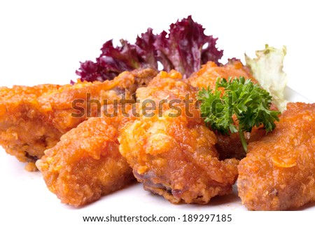 fried bird in sour sweet sauce with parsley leaves. on a white background