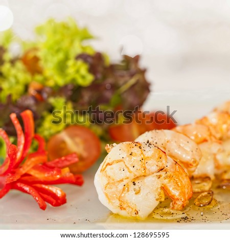 fried black tiger prawns with herbs and spices - stock photo
