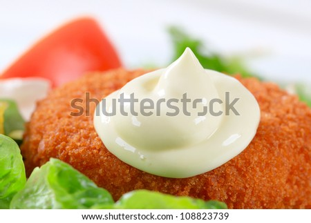 Fried breaded cheese with mayonnaise - stock photo
