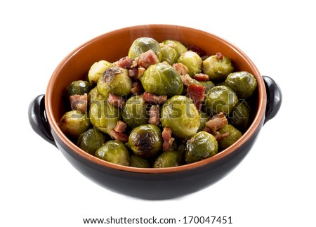 "Fried Brussel Sprouts with ham called ""speck""  - stock photo"