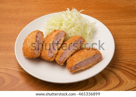fried cake of layered slices of ham