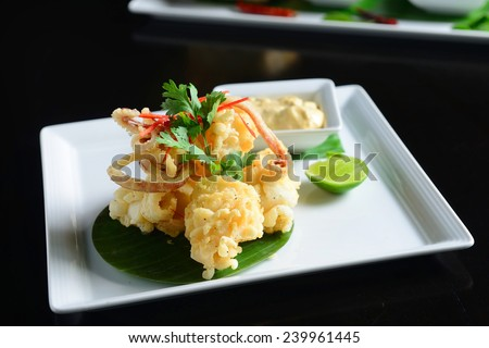 fried calamari, fried squid with sauce - stock photo