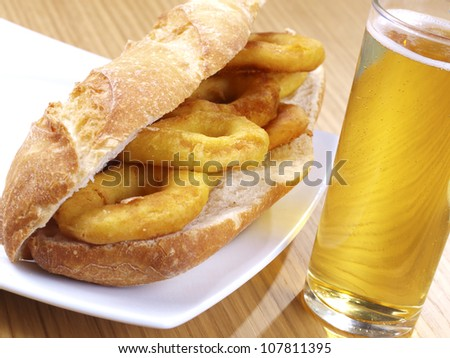 Fried Calamari. Spanish Tapa. �Tapas� are typical spanish appetizer. One of them: �Calamares a la romana�,  batter-coated squid rings deep fried, and served with lemon on the side, or  as a sandwich.