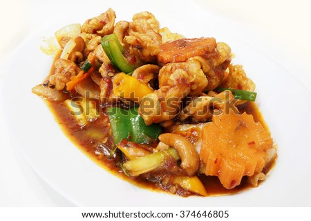 Fried cashew chicken in the white plate