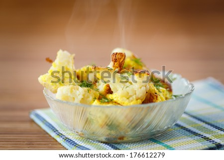 fried cauliflower in a bowl on the table