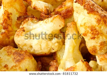 fried cauliflower in batter on a plate closeup - stock photo