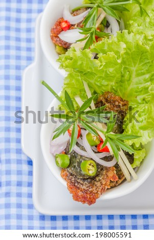 Fried century egg Salad or Yum. Thaifood
