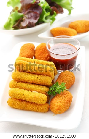 Fried cheese sticks - mozzarella and chilli pepper filled with cheese and tomato sauce - stock photo